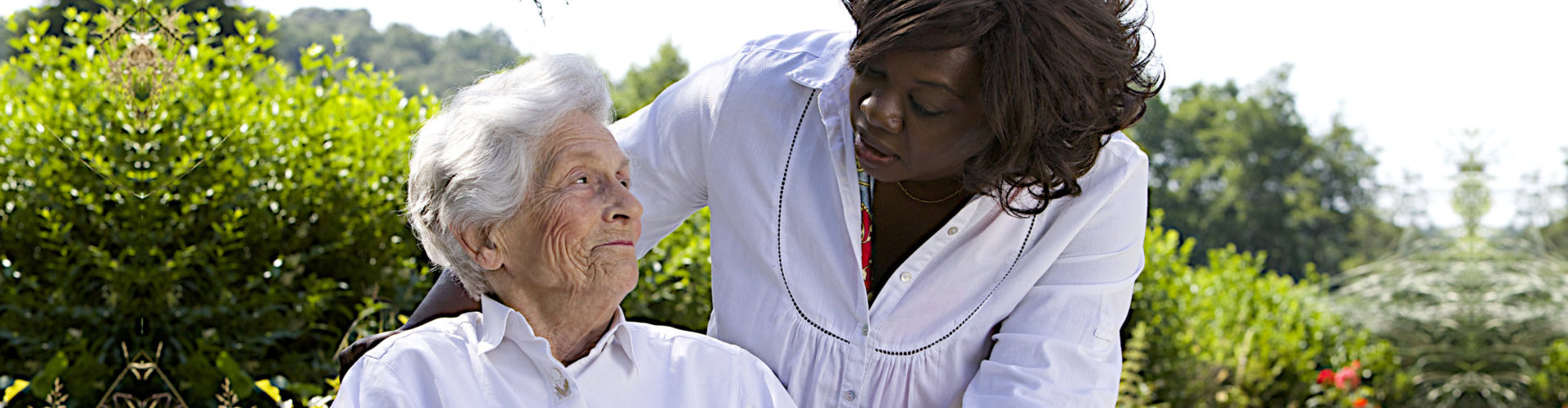 caregiver taking care of senior woman